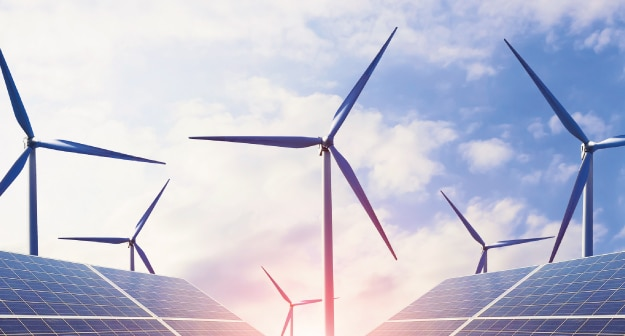 engineering services for wind and solar sector with wind turbines and solar panels on the background